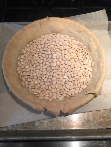 The crust: it really helps to line it with parchment before putting the beans down (which keeps it from bubbling up)